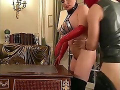 Mature in thigh high boots and red gloves comes back for another ass fuck
