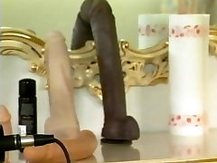 Retro German babe fucks herself on camera