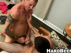 These two hot buff tattooed hunks are having some hot anal sex