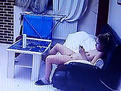 Naked girl in the living room with her mobile