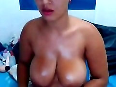 Busty big tit latina milf fingers her wet pussy