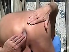 Me naked outside playing with a 6 inch long x 2 inch thick Ice Cube Cock.