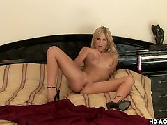 Blonde Goddess jams a pink dildo down her tube