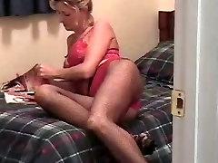 Slut Wife masterbating while looking at dirty mag