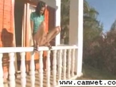 Girl peeing off the porch