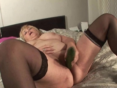 Chubby mature toying with veggie