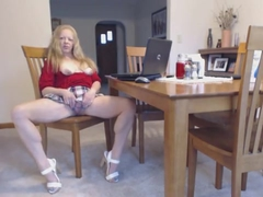 Mature lady in short skirt and high heels spreads her pussy and shows her tits