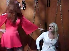 Mistress dominates tied girl with some BDSM items