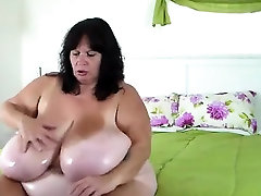 Hot Fat Mature Massages Her Giant Tits