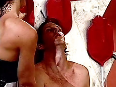 A BDSM couple gives guy ass rinsing
