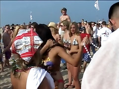 Flashing party girls get groped at the beach